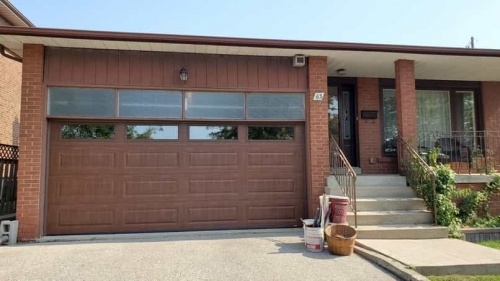 Brown double-car garage door installation for a house in Lakeshore Mississauga by Pro Entry