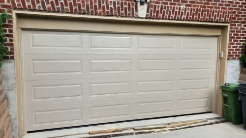 Double-Car garage door without windows installed in Toronto by Pro Entry