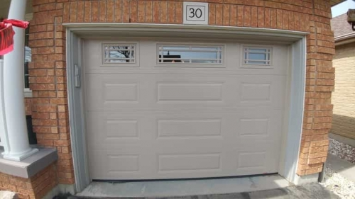 Light Brown single-car garage door installed by Pro Entry in Ontario