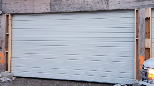 white color garage door with no windows installed by Pro Entry Services