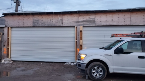 white color garage doors with no windows installed by Pro Entry Services