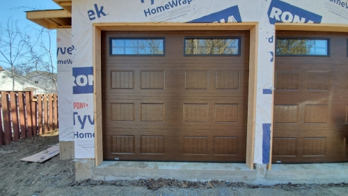 Traditional style brown color garage door installed for a house in Milton by Pro Entry Services