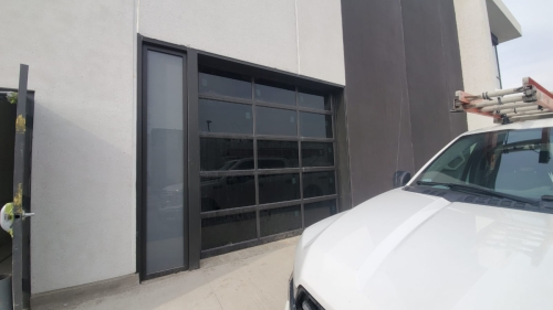 Aluminum glass garage door installed by Pro Entry Services