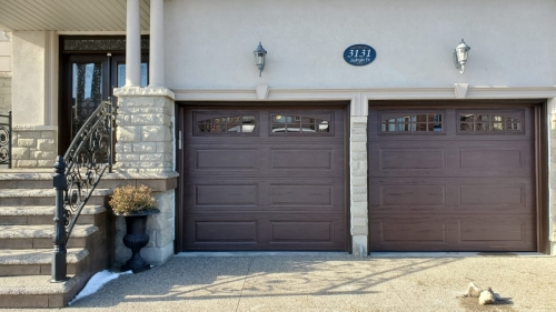 2 Single garage doors installed by Pro Entry Services