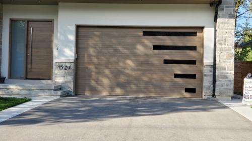 Modern-garage-door-with-horizontal-windows-Pro-Entry-Services