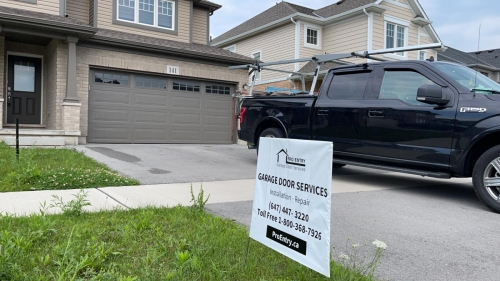 New-traditional-garage-door-installation-for-home-in-Milton-Pro-Entry-Services